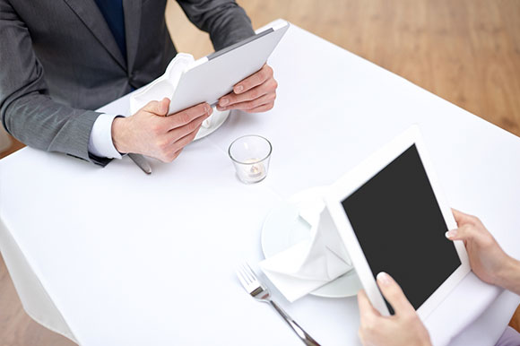 Customers Using Tablets to Make Orders